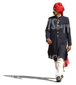 hindu man in a traditional attire and wearing a turban walking