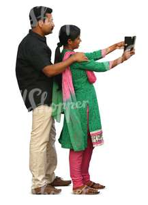 indian couple standing and taking a selfie
