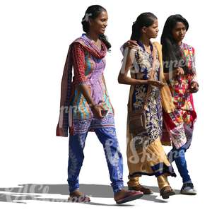 three young hindu women wearing traditional indian clothes walking and talking