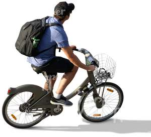 man with a backpack riding a bike