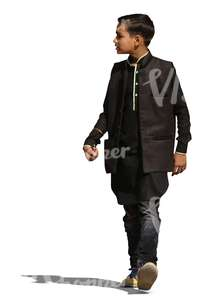 indian boy in a traditional jacket walking