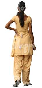hindu woman in a yellow salwar kameez standing