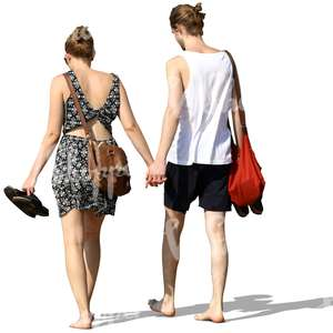young couple walking barefoot and hand in hand