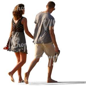 couple walking barefoot and holding hands