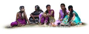 group of indian women sitting on the grass