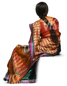 indian woman wearing a sari sitting
