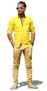 indian man in a yellow shirt standing