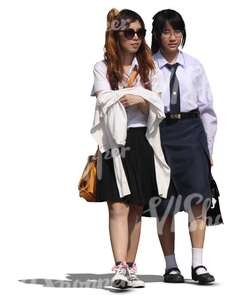 two teenage asian schoolgirls walking