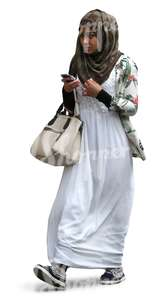 black muslim woman walking with a phone in her hand