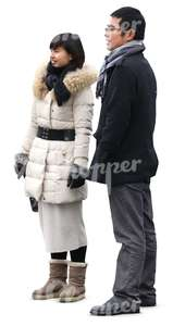 asian man and woman in winter clothes standing together