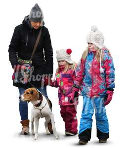 family with two children and a dog walking