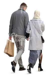 man and woman in a grey coat walking hand in hand
