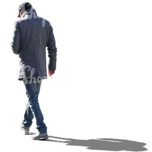 backlit man in a grey coat walking