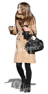 woman walking with a coffee cup in her hand