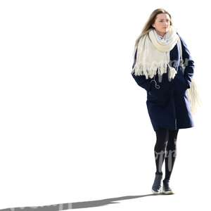 woman in a blue coat and white scarf walking