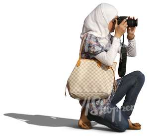 muslim woman kneeling while taking a picture