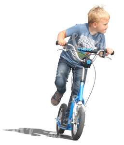 blond boy riding a scooter