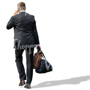 businessman carrying two bags and talking on the phone