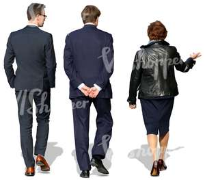 woman and two men in suits walking and talking