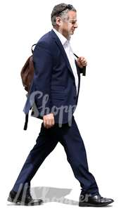 businessman with a leather backpack walking
