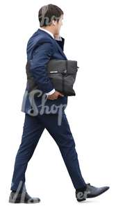 businessman with a briefcase walking and talking on the phone