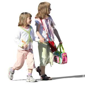 two little girls walking hand in hand