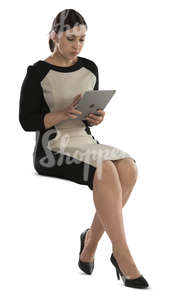 businesswoman sitting and working on her ipad