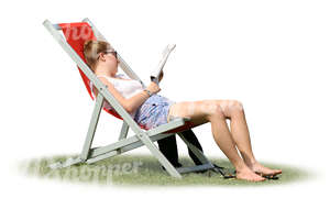 woman sitting in a sling chair and reading a magazine.