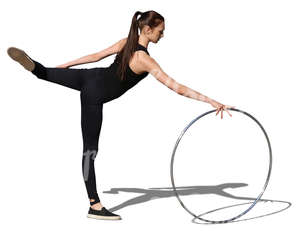 young gymnast performing with a hoop