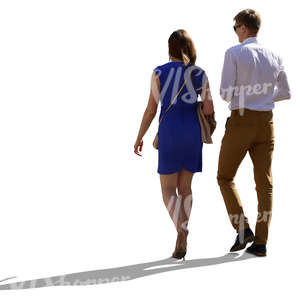 neatly dressed backlit couple walking side by side