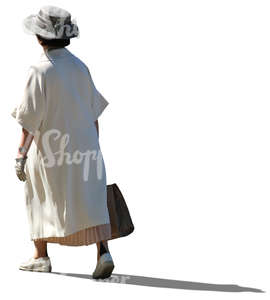 elderly lady in a white summer coat walking