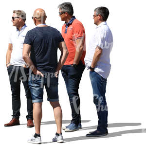 group of men standing and looking at smth