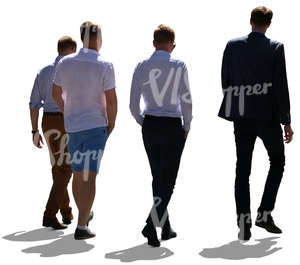 backlit group of four men walking