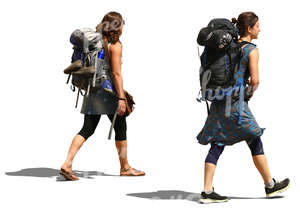 two women with huge backpacks walking on the road