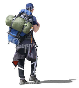 man with a hiking backpack walking in the sunlight