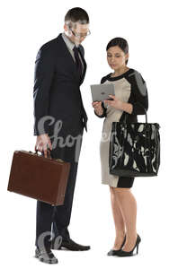 businessman and businesswoman standing and looking at ipad