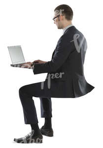 young businessman sitting and working with his laptop