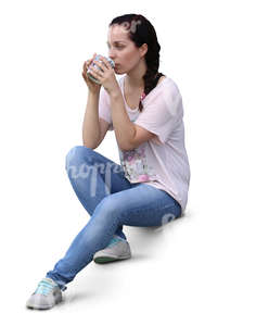 woman sitting on the stairs and drinking coffee