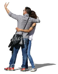 asian couple taking a selfie while hugging each other
