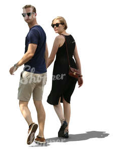 couple walking hand in hand in tree shade