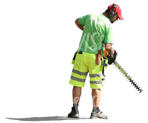 man working with a hedge trimmer