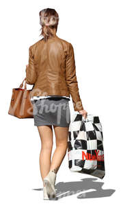 woman walking with a huge shopping bag