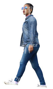 black woman in denim clothing walking seen from below