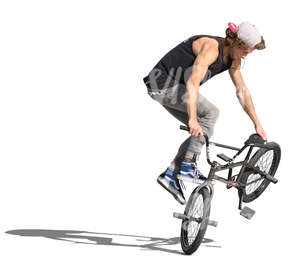 young man performing a stunt with his bmx