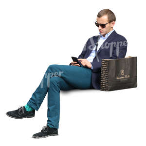 man with a shopping bag sitting on the bench