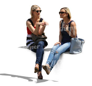 two women sitting and talking