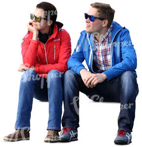 man and woman with sunglasses sitting and looking at smth