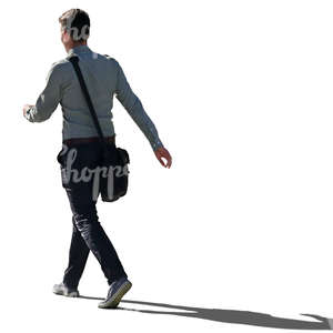 backlit man walking hastily