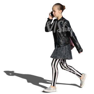 young girl in striped leggings walking and talking on the phone