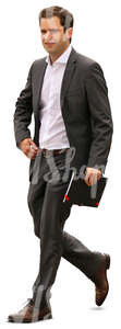 businessman with a notebook walking in the office